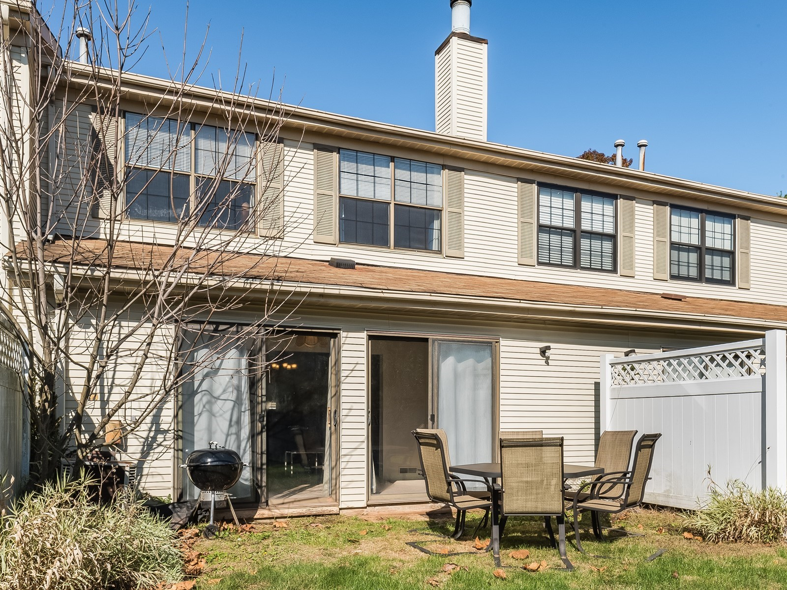 Piscataway 147 Furnished housing backyard with sliding glass door to outdoor seating area and grill