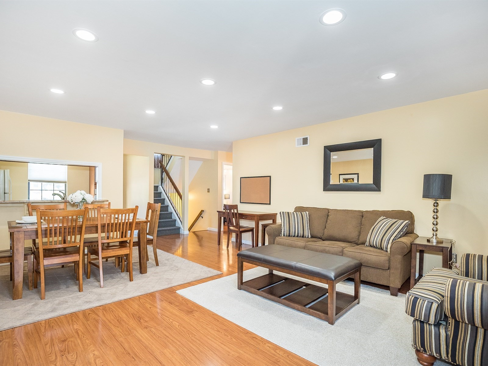 Woodbridge 4 Temporary Housing spacious floorplan with living room, dining area and view to staircase