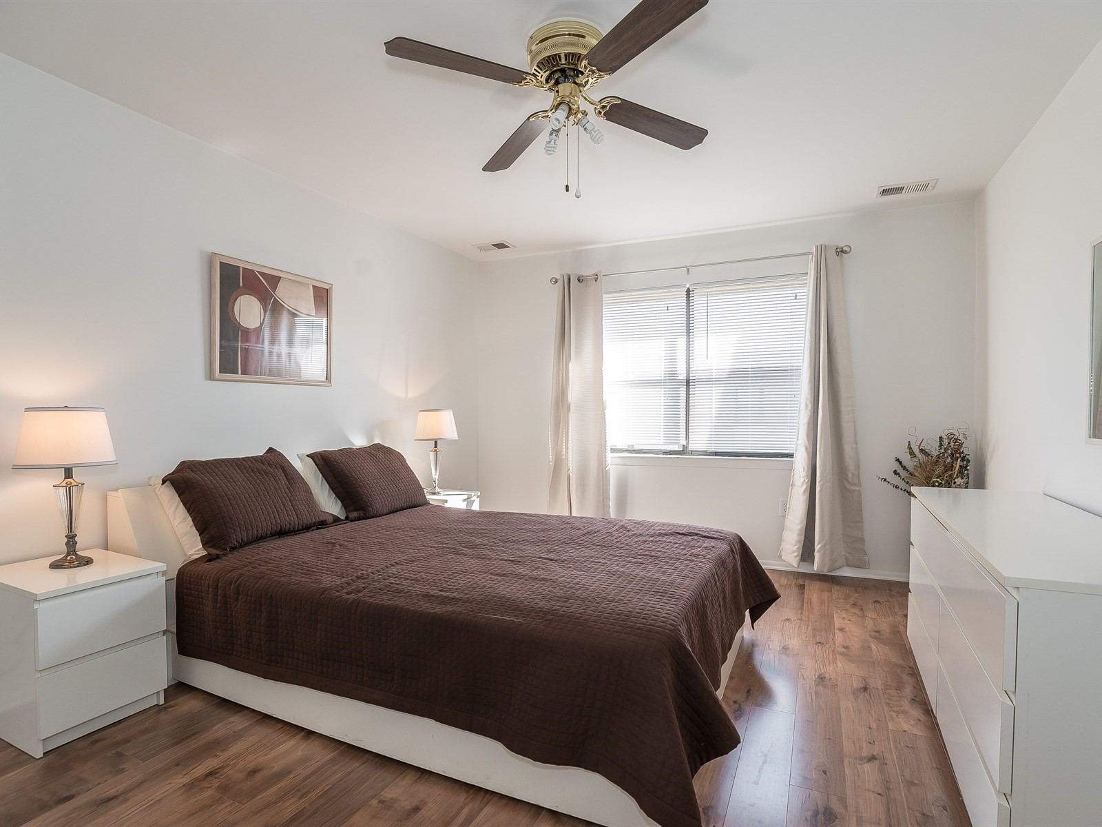 North Brunswick 608 Short Term Housing Master bedroom with large bed, dressers and window
