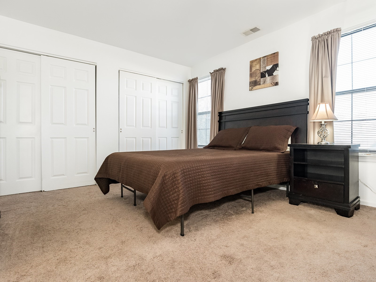 Woodbridge 404 Furnished Apartment Bedroom with large tv and spacious closets