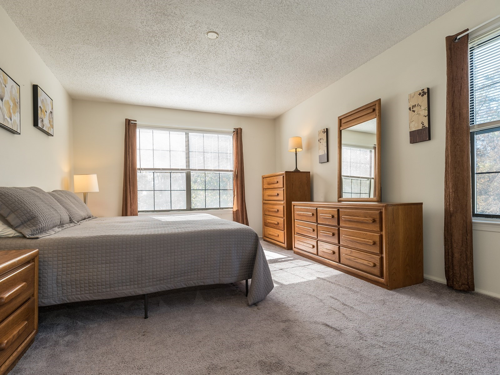 Piscataway 260 short term rental Master bedroom with large bed, nightstand and two dressers
