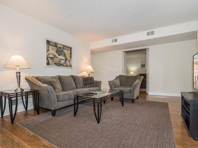 North Brunswick Temporary Housing living room with large couch, love chair and coffee table