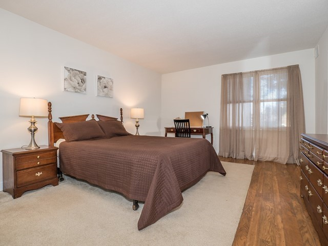 North Brunswick Temporary Housing master bedroom with dress, desk and two nightstands