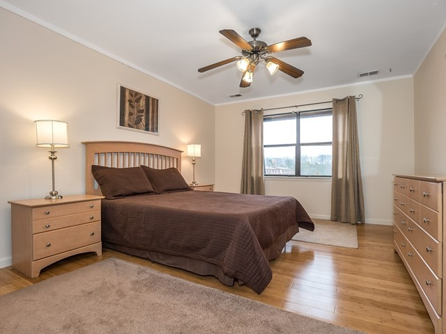 North Brunswick 1212 furnished housing master bedroom with large bed, two nightstands and full dresser